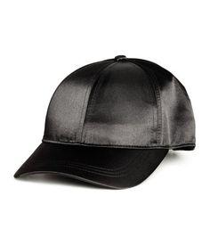 Black. Satin cap with adjustable metal fastener at back.