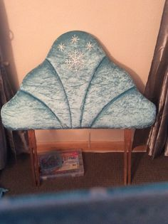 Old headboard reupholstered in a Frozen theme