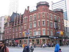 The Starbucks currently located on the North West intersection of College Street and Yonge Street is fluid with over 100 years of intriguing history. Constructed in 1891 to 1893 by Dick & Wickson Architects and influenced by the Gothic Revival, Oddfellows' Hall became home to local retail shops, cigar sellers, business owners investing in office space, The Bank of Commerce, and Toronto's elite Independent Order of Odd Fellows