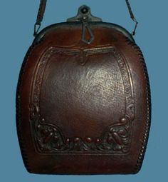 1910s Arts and Crafts embossed leather bag  - Courtesy of thespectrum.  From the Fashion Timeline at The Vintage Guild