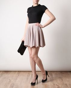 Azzedine Alaïa perforated stretch knit skirt from Browns. Perfect for an evening dinner.