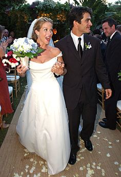 """""""Married with Children"""" actress Christina Applegate and Johnathan Schaech were married on October 20, 2001 at the three-acre Cree Estate in Palm Springs, California. The bride walked down the aisle with two parents wearing a hand-beaded silk organza off- the shoulder gown by Reem Acra. Reem Acra gowns are sold at The Bridal Salon at Saks Jandel."""