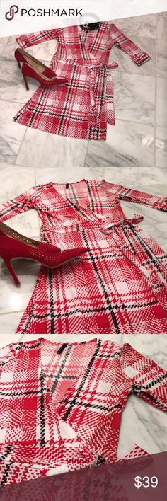 Red, Black and White Wrap Dress! It's a wrap!  You will be smoking' hot in this little number.  I love a wrap dress, and this has been one of my favorites.  Bold red, black and white are the perfect combination. Kori Dresses