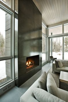 Fabulous concrete mountain retreat in Snowmass Fireplace in steel with an acid wash and lacquer - Designed by Kaegebein Fine Homebuilding - Capitol Creek Road, Snowmass, Colorado. Metal Fireplace, Concrete Fireplace, Home Fireplace, Fireplace Surrounds, Fireplace Design, Fireplace Cover, Stain Concrete, Black Fireplace, Fireplace Mirror