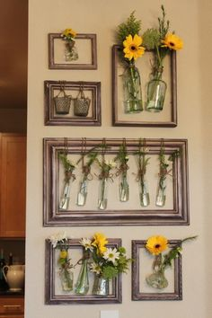 hanging flowers. also would be cool without vases, using dried flora and fauna.