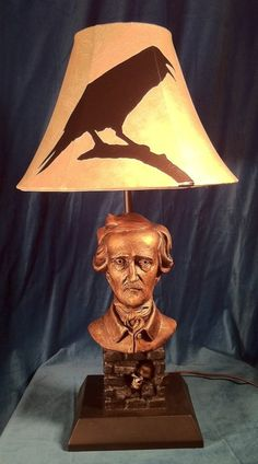 Literary Lamps -- Edgar Allan Poe - Unique reading lamp, incorporating a 1/2 life-size bust of the famous author and poet. It is made of resin and painted to look bronze.