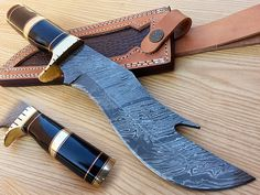 Damascus Hunting knife HK-53  Open Length: 13 Inches Blade Length: 8 Inches Handle Length: 5 Inches Price: $110USD Handle made of bull horn, brass   FREE SHIPPING