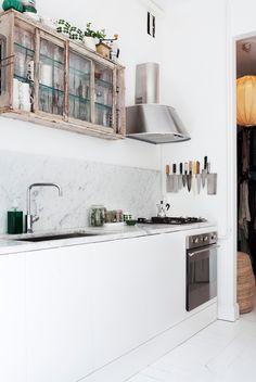 white kitchen and rustic shelf