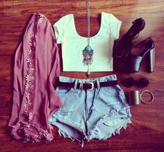 Denim shorts with top white cropped short blouse and stone necklace and leather belt and black leather high heels sandals and floral modern cardigan and black goggles the best way to show teen fashion