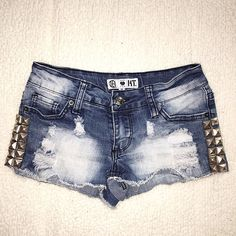 Studded Shorts Size 0. Medium wash / fade. Studded detail. Silver hardware. Cotton / poly / spandex. Length 8 1/2, waist flat 13, inseam 2. Jet Shorts Jean Shorts