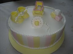 A baby shower cake I was asked to make. First time I`ve made sugar paste cake toppers, very happy how they came out.