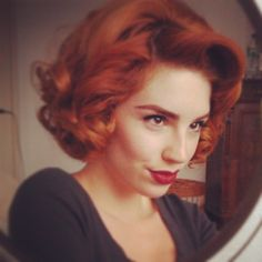 Short red retro hairstyle. Pin curls.