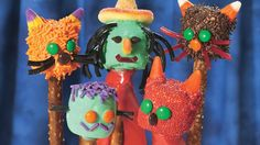 Perfect for party favors, snack buffets or a kiddie activity, these marshmallow monsters-on-a-stick are pure Halloween fun.