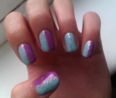 Something like this, or mainly purple nails with silver tips and one blue nail with silver tip