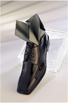 Top your tuxedo off with a black cosmopolitan shoe