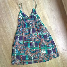 Pins & Needles Boho Sundress NWOT Made of a crinkled India cotton. Adjustable straps. Runs small. Size 6 is the max on this. Elastic band under bust. Never worn. Anthropologie Dresses