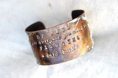 cuff. hammered. pies, ?para qué los quiero si tengo alas para volar? feet, why would I want them if I have wings to fly? Frida Kahlo. right wrist.
