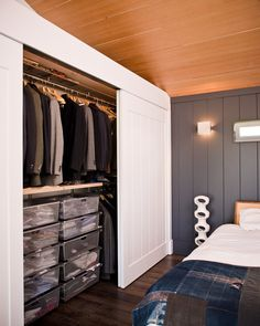 Closet idea for small bedroom/guest room.  Basement? Could you get wood ceiling panels