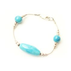 The classic combination of turquoise and sterling silver make this bracelet really stunning.   this white clay ceramic bracelet is light and easy to wear, making it a fantastic present for someone special or for the most important person: yourself!!!