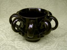 Small 17th / 18th century pottery wassail type bowl with a rich reddish brown glaze