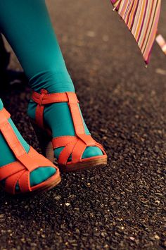 teal tights & orange shoes...wild, but in a good way, I would do it with flats..