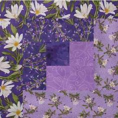 Love this Purple Daisy Simple Pleasure Floral Log Cabin Block. I think the fabric really sets it off.