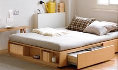 Bed frames with drawers, baskets, and other compartments perfect for small quarters.