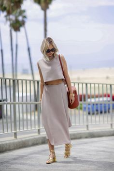Blush skirt set paired with gold Zara heels and a bucket bag.