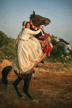 Kurdish woman on rearing horse