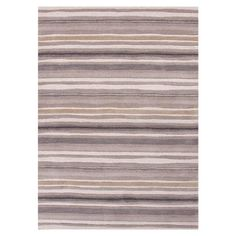 Bring visual appeal to your den or define areas in the living room with this lovely hand-tufted wool rug, showcasing a stripe motif in gray and ivory.