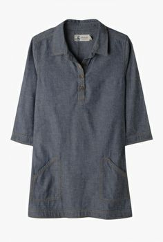 Towednack Tunic   Classic chambray tunic. Falls to mid thigh, with mock horn effect buttons and shirt collar. Two lower front patch pockets and three quarter length sleeves.  Looks effortlessly stylish with tights and flats. A staple item in your wardrobe.