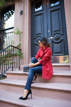 red trench coat, jeans and black pump heels