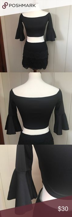 Nasty Gal crop top So sexy Nasty Gal black crop top with dramatic bell sleeves. Has a lot of stretch. Worn once. Great condition. Skirt is free People not included but in my closet for sale! Nasty Gal Tops Crop Tops