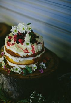 What a fabulous cake!  http://hellomay.com.au/article/lauren-tom-raining-winter-wedding-perth-photographer-still-love/