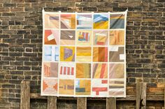 apotospitimou:    Brian's Improv Patchwork quilt top (by the workroom)