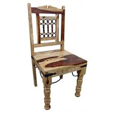 Southwest Furniture :- Solid hardwood dining chair. Spanish Tuscan look and feel with handmade iron accents. These chairs work with any of our Spanish Colonial tables. Chairs are sold in pairs only. Price is per chair. Dimensions: 18.5'' l x 39.5'' h x 18.5'' w Seat height is 18.5.