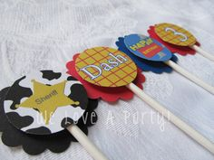 Toy Story Inspired Cupcake Toppers. woody. sheriff. set of 12 cupcake toppers. toy story birthday party. $6.00, via Etsy.
