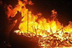 A Viking longboat burns during the annual Up Helly Aa festival in Lerwick, Shetland Islands, on January 26, 2016. Up Helly Aa celebrates the influence of the Scandinavian Vikings in the Shetland Islands and culminates with up to 1,000 <em>guizers</em>, men in costume, throwing flaming torches into their Viking longboat and setting it alight later in the evening.