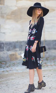 Belted floral print dress accessorized with studded boots and a wide brimmed hat