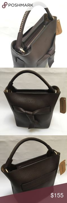 Brown chic Genuine leather handbags This European designed and crafted handbag can be found nowhere else in the USA. Beautiful genuine leather handbag manufactured in Europe with top quality leather. The intricacy and quality is hard to beat. Pictures include front and back of bag as well as inside of bag. Each bag has a detachable shoulder strap and a purse which is attached to the inside of bag. Dimensions: 10 X 11 x 6 inch. Bags Shoulder Bags