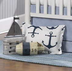 There are so many options with a nautical nursery theme.  Want to shake things up? Try pairing modern patterns, with antique-style accents or furnishings.