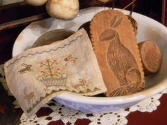 A RABBIT MOLD AND A STITCHERY IN AN IRONSTONE BOWL.