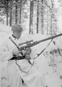 A Finnish soldier holds a Russian Mosin-Nagant sniper rifle during the Winter War (February 13, 1940).