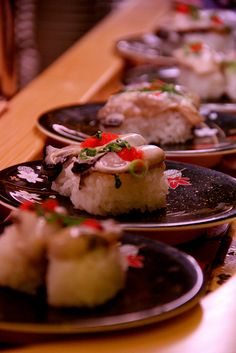 Japanese sushi diner, Kaiten-zushi 回転寿司 - sushi on a conveyor belt