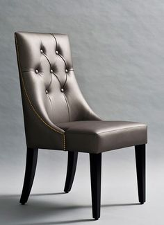 Esme Dining Chair  490mm (W) X 875mm (H) X 555mm (D) Leather upholstered dining chair with button tufting and brass nailhead trim.  Custom finishes available.