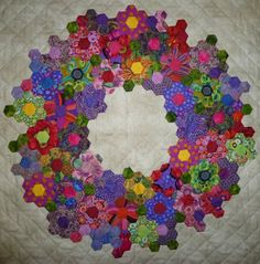 ...just Quilts: Delden Quilt Exhibition I never thought of using hexies for a wreath!