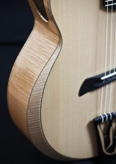 Flamed maple, Sitka spruce top with ebony purfling by Batson Guitars.