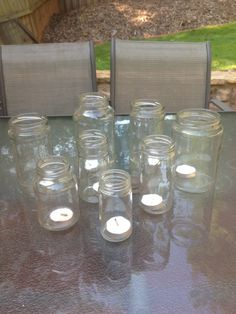 Old glass jars from spaghetti sauce, pickles, olives, etc reused as outdoor candle holders!
