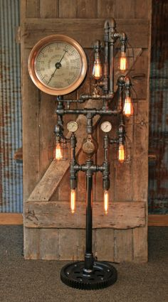 Amazing floor lamp made from antique steam gauges and gears. Steampunk Table, St Louis, Lampe Tube, Pipe Lighting, Vintage Industrial Decor, Lamp Socket, Pipe Lamp, Bedroom Lamps, Stairway