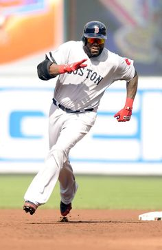BALTIMORE, MD - JUNE 15:  David Ortiz #34 of the Boston Red Sox hits a triple in the second inning during a baseball game against the Baltimore Orioles on June 15, 2013 at Oriole Park at Camden Yards in Baltimore, Maryland.  (Photo by Mitchell Layton/Getty Images)